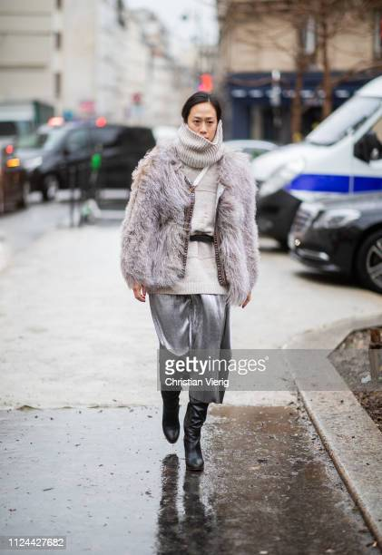 A guest is seen wearing grey fake fur jacket turtleneck outside Maison Margiela during Paris Fashion Week Haute Couture Spring Summer 2019 on January...