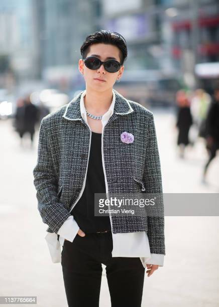 A guest is seen wearing grey jacket white button shirt at the Hera Seoul Fashion Week 2019 F/W at Dongdaemun Design Plaza at Dongdaemun Design Plaza...