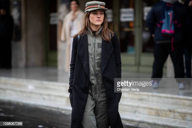 A guest is seen wearing grey overall flat cap outside Stephane Rolland during Haute Couture Spring Summer 2019 Day Two on January 22 2019 in Paris...