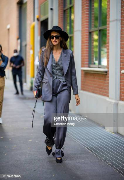 Guest is seen wearing grey pants and blazer, hat outside Fendi during the Milan Women's Fashion Week on September 23, 2020 in Milan, Italy.