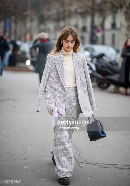 A guest is seen wearing grey plaid coat outside Acne during Paris Fashion Week Menswear F/W 20192020 Day Six on January 20 2019 in Paris France