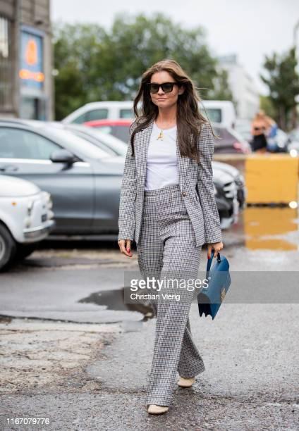 A guest is seen wearing grey suit outside Baum und Pferdgarten during Copenhagen Fashion Week Spring/Summer 2020 on August 08 2019 in Copenhagen...