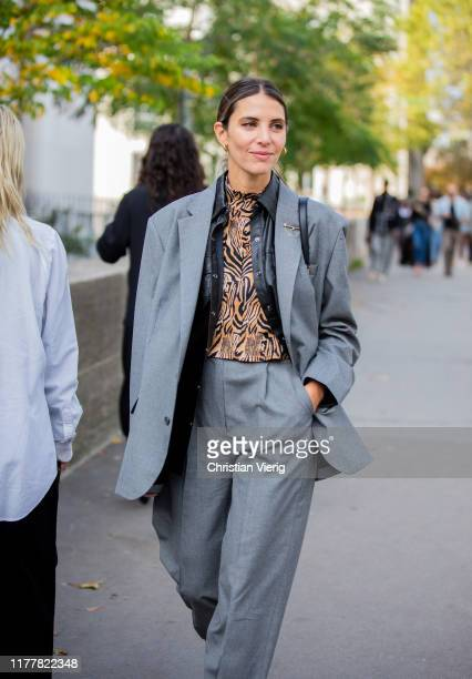 A guest is seen wearing grey suit outside Haider Ackermann during Paris Fashion Week Womenswear Spring Summer 2020 on September 28 2019 in Paris...