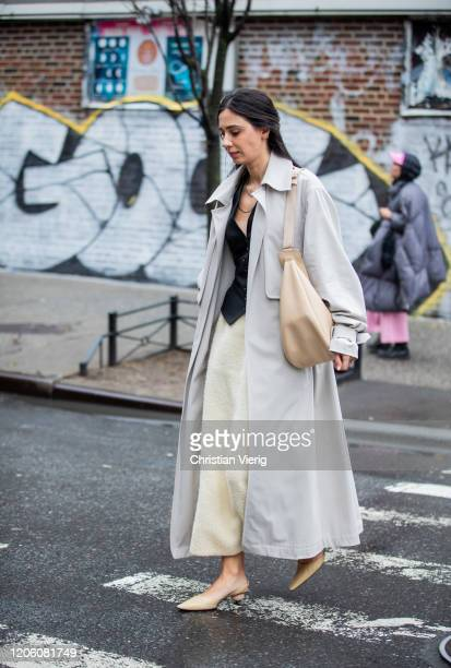Guest is seen wearing grey trench coat outside Gabriela Hearst during New York Fashion Week Fall / Winter on February 11, 2020 in New York City.