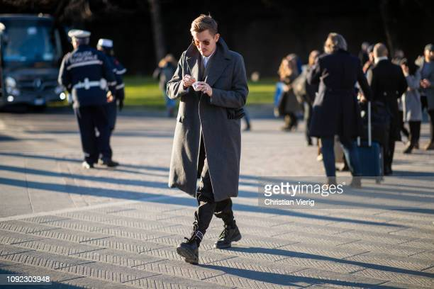 A guest is seen wearing grey wool coat during the 95th Pitti Uomo at Fortezza Da Basso on January 10 2019 in Florence Italy