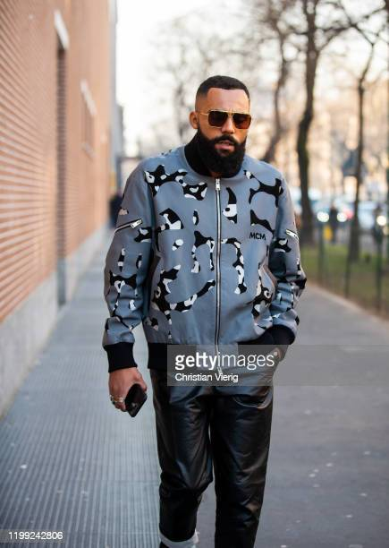 A guest is seen wearing grey zipped MCM jacket black leather pants outside Fendi during Milan Fashion Week Fall/Winter 2020/2021 on January 13 2020...