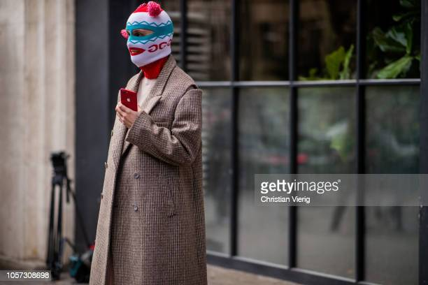Guest is seen wearing Gucci ski mask during Mercedes-Benz Tbilisi Fashion Week on November 4, 2018 in Tbilisi, Georgia.