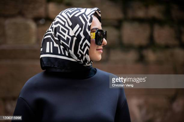 A guest is seen wearing Gucci sunglasses head scarf outside Michael Kors during New York Fashion Week Fall / Winter 2020 on February 12 2020 in New...