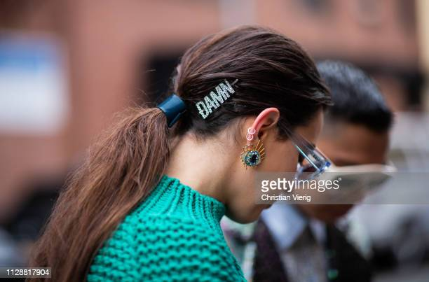 A guest is seen wearing hair clip earring outside Tibi during New York Fashion Week Autumn Winter 2019 on February 10 2019 in New York City
