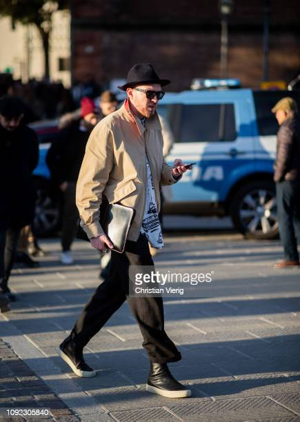 A guest is seen wearing hat beige jacket during the 95th Pitti Uomo at Fortezza Da Basso on January 10 2019 in Florence Italy