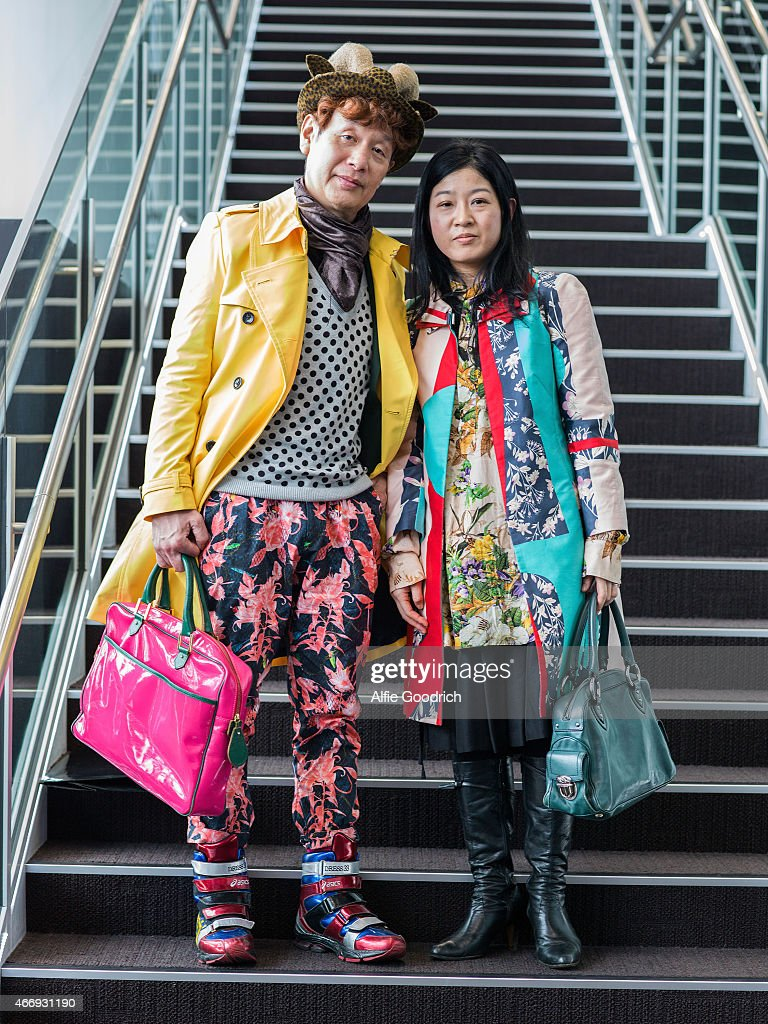 A guest (L) is seen wearing hat by Sawa, coat by Lorinza, suit trousers by Yoshio KUBO and shoes by Dress33 and guest (R) is seen wearing vintage coat by Chrstian Lacroix, skirt and shirt by GalaabenD during the Mercedes Benz Fashion Week TOKYO 2015 A/W at Shibuya Hikarie on March 19, 2015 in Tokyo, Japan.