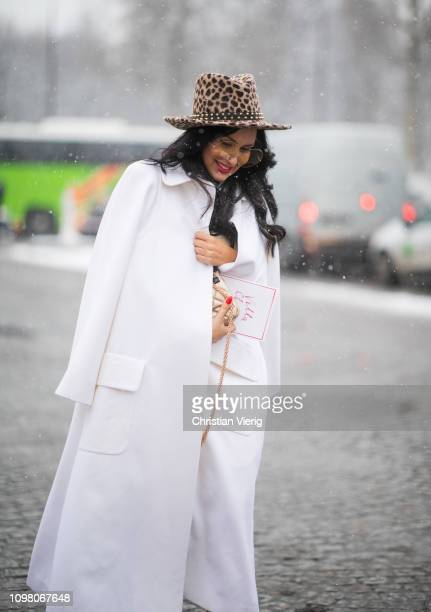 A guest is seen wearing hat with animal print hat white coat outside Chanel during Haute Couture Spring Summer 2019 Day Two on January 22 2019 in...