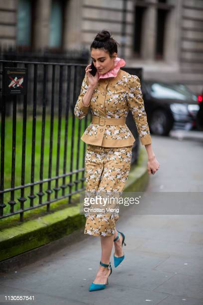 A guest is seen wearing jacket and pants with print outside Erdem during London Fashion Week February 2019 on February 18 2019 in London England