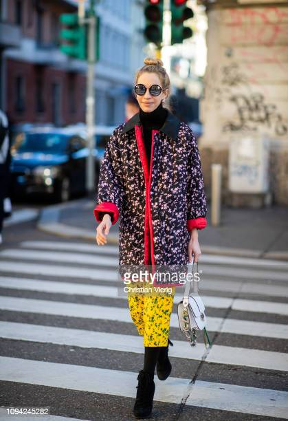 A guest is seen wearing jacket and skirt with floral print outside N21 during Milan Menswear Fashion Week Autumn/Winter 2019/20 on January 14 2019 in...