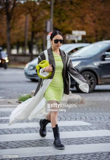 Guest is seen wearing jacket, neon dressoutside Acne during Paris Fashion Week - Womenswear Spring Summer 2021 : Day Three seen on September 30, 2020...
