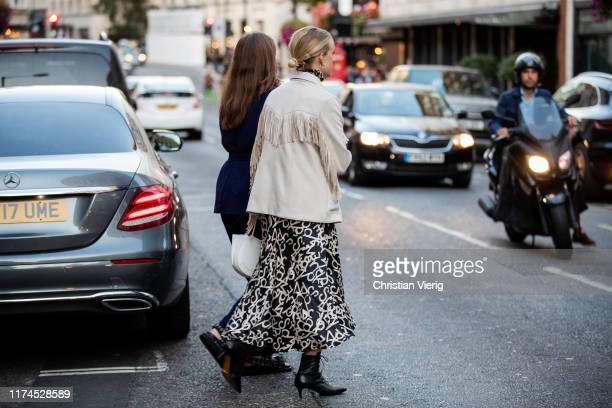 Guest is seen wearing jacket with fringes outside Temperley London presentation during London Fashion Week September 2019 on September 13, 2019 in...