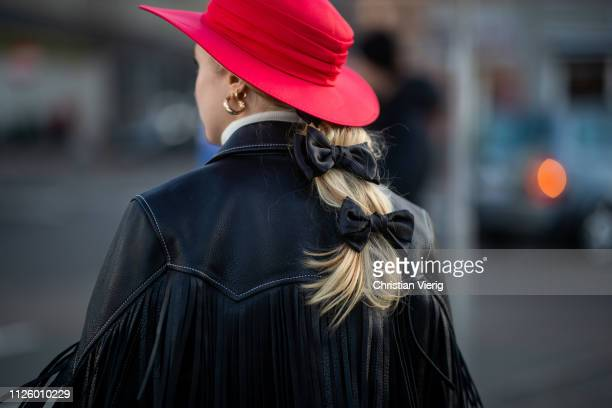 Guest is seen wearing jacket with fringes, red hat outside Blanche during the Copenhagen Fashion Week Autumn/Winter 2019 - Day 1 on January 29, 2019...
