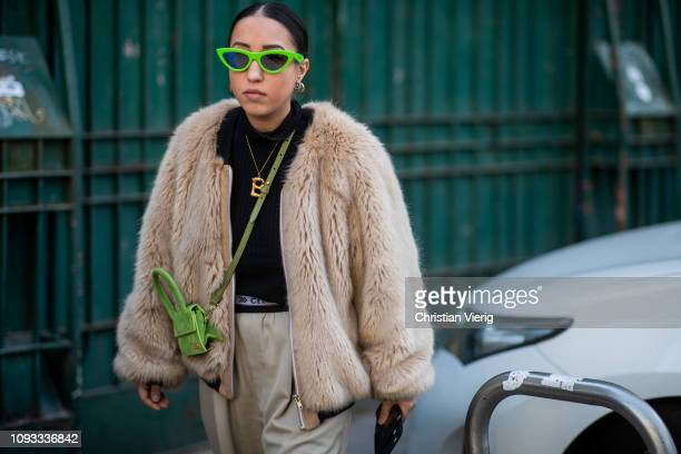 A guest is seen wearing Jacquemus bag beige teddy jacket outside Marni during Milan Menswear Fashion Week Autumn/Winter 2019/20 on January 12 2019 in...