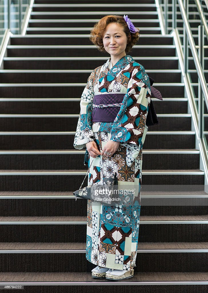 A guest is seen wearing kimono and bag by Jotaro Saito during the Mercedes Benz Fashion Week TOKYO 2015 A/W at Shibuya Hikarie on March 19, 2015 in Tokyo, Japan.