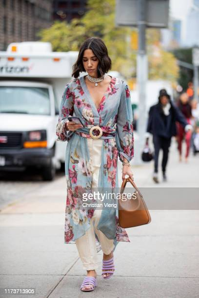 Guest is seen wearing kimono with floral print outside Sally LaPointe during New York Fashion Week September 2019 on September 10, 2019 in New York...