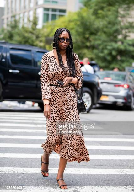 A guest is seen wearing leopard dress outside Zimmermann during New York Fashion Week September 2019 on September 09 2019 in New York City
