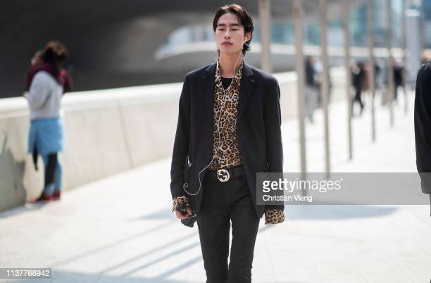 A guest is seen wearing leopard print button shirt at the Hera Seoul Fashion Week 2019 F/W at Dongdaemun Design Plaza at Dongdaemun Design Plaza on...