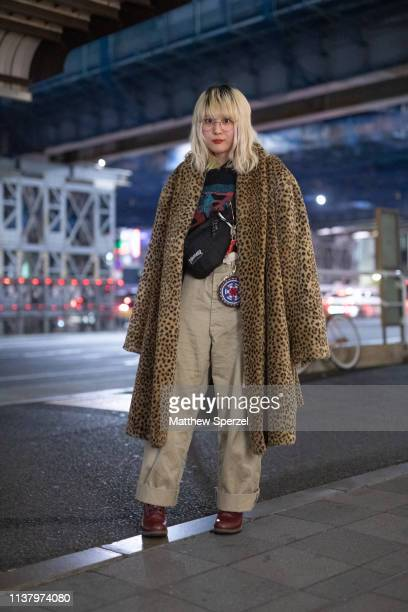 A guest is seen wearing leopard print coat khaki pants during the Amazon Fashion Week TOKYO 2019 A/W on March 23 2019 in Tokyo Japan