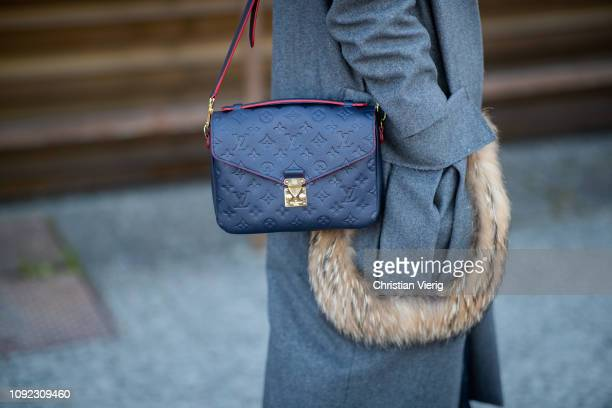 A guest is seen wearing Louis Vuitton bag during the 95th Pitti Uomo at Fortezza Da Basso on January 10 2019 in Florence Italy