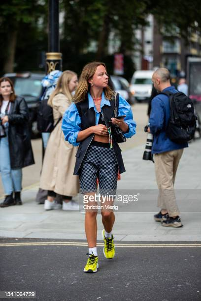 Guest is seen wearing Louis Vuitton shorts, button shirt, vest outside Nensi Dojaka during London Fashion Week September 2021 on September 17, 2021...