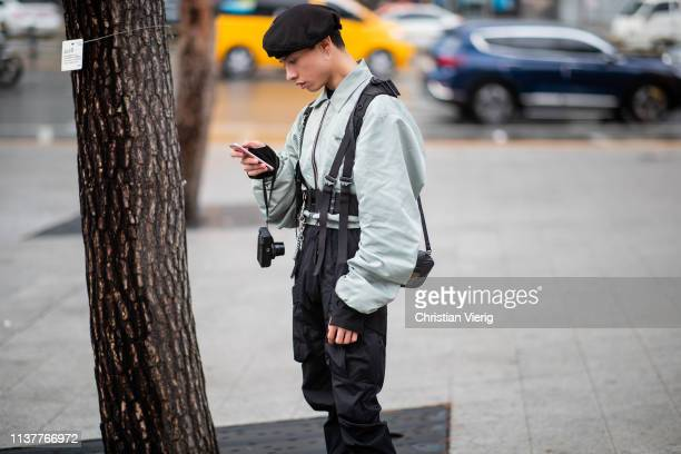 A guest is seen wearing miltary pants beret jacket belt at the Hera Seoul Fashion Week 2019 F/W at Dongdaemun Design Plaza at Dongdaemun Design Plaza...