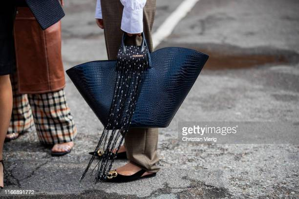 Guest is seen wearing mini Jacquemus bag outside By Malene Birger during Copenhagen Fashion Week Spring/Summer 2020 on August 08, 2019 in Copenhagen,...