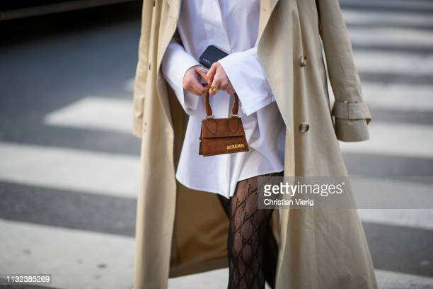 A guest is seen wearing mini Jacquemus bag outside Marques Almeida during Paris Fashion Week Womenswear Fall/Winter 2019/2020 on February 26 2019 in...