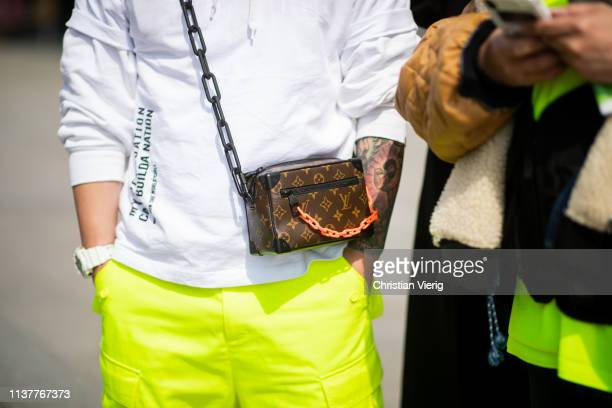 A guest is seen wearing mini Louis Vuitton bag at the Hera Seoul Fashion Week 2019 F/W at Dongdaemun Design Plaza at Dongdaemun Design Plaza on March...