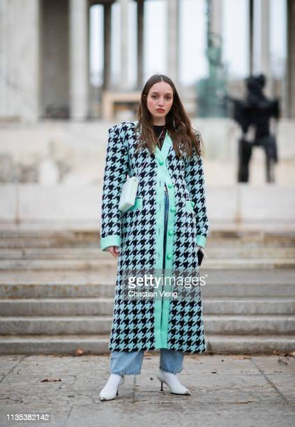 A guest is seen wearing mint colored coat with pattern outside Tods lunch during Paris Fashion Week Womenswear Fall/Winter 2019/2020 on March 05 2019...