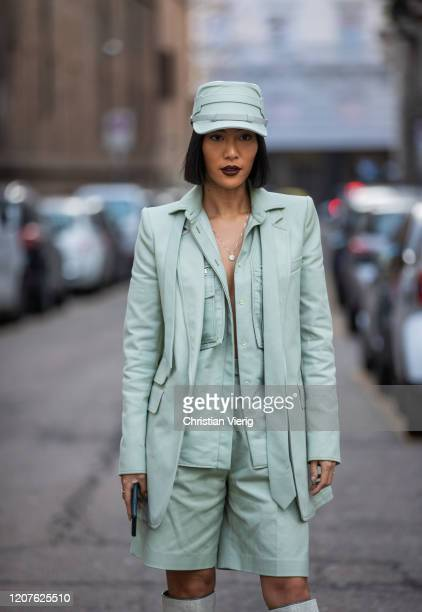 A guest is seen wearing mint green hat shorts blazer boots outside Max Mara during Milan Fashion Week Fall/Winter 20202021 on February 20 2020 in...