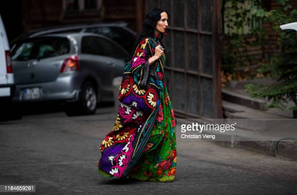 Guest is seen wearing multi colored kimono with floral print, dress and bag during day 1 of the Mercedes-Benz Tbilisi Fashion Week on October 31,...