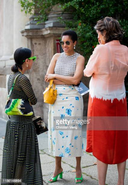 A guest is seen wearing multi colored Prada bag and Tamu McPherson outside M1992 during the Milan Men's Fashion Week Spring/Summer 2020 on June 15...