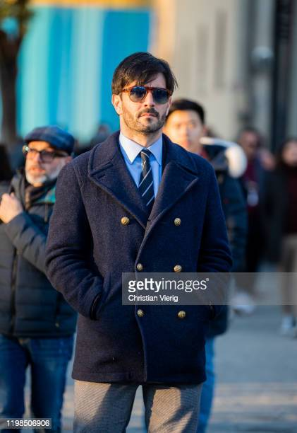 Guest is seen wearing navy doble breasted jacket during Pitti Uomo 97 at Fortezza Da Basso on January 09, 2020 in Florence, Italy.
