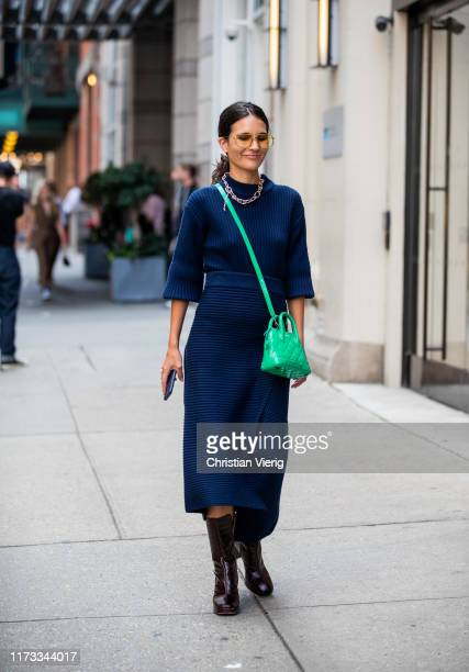Guest is seen wearing navy skirt outside Tibi during New York Fashion Week September 2019 on September 08, 2019 in New York City.
