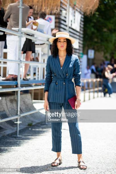 A guest is seen wearing navy striped suit during Pitti Immagine Uomo 96 on June 13 2019 in Florence Italy