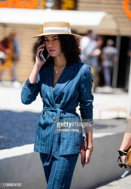 Guest is seen wearing navy striped suit during Pitti Immagine Uomo 96 on June 13, 2019 in Florence, Italy.