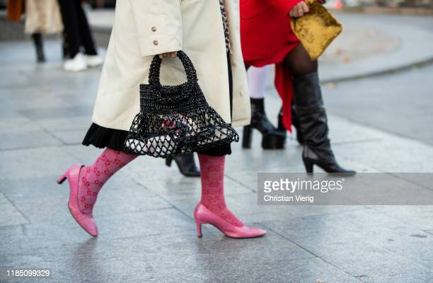 Guest is seen wearing net bag, Gucci tights, pink shoes during day 3 of the Mercedes-Benz Tbilisi Fashion Week on November 02, 2019 in Tbilisi,...