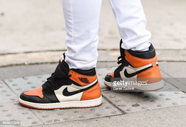 A guest is seen wearing Nike sneakers outside of the General Idea show during New York Fashion Week Men's AW17 on February 2 2017 in New York City