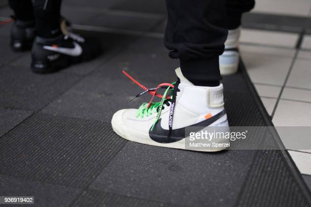 A guest is seen wearing Nike x OffWhite shoes during the Amazon Fashion Week TOKYO 2018 A/W on March 22 2018 in Tokyo Japan