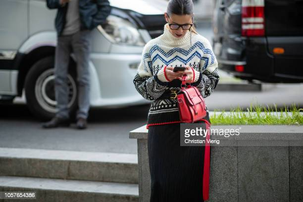 A guest is seen wearing Norwegian knit during MercedesBenz Tbilisi Fashion Week on November 5 2018 in Tbilisi Georgia