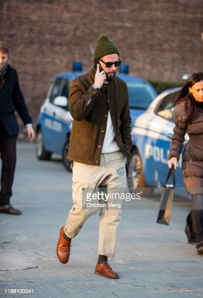 A guest is seen wearing olive üants brown jacket during Pitti Uomo 97 at Fortezza Da Basso on January 07 2020 in Florence Italy