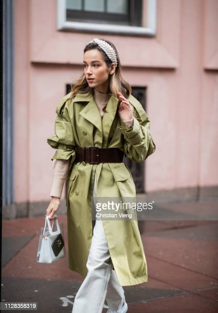 A guest is seen wearing olive belted coat outside Nanushka during New York Fashion Week Autumn Winter 2019 on February 08 2019 in New York City