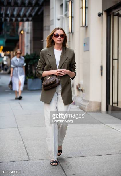 Guest is seen wearing olive blazer outside Tibi during New York Fashion Week September 2019 on September 08, 2019 in New York City.