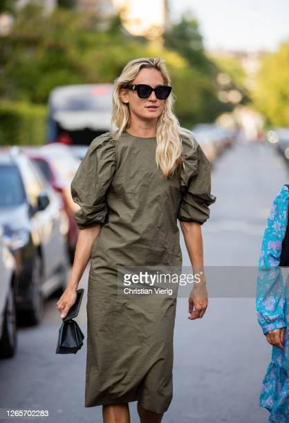 Guest is seen wearing olive dress outside By Malene Birger during Copenhagen Fashion Week Spring/Summer 2021 on August 12, 2020 in Copenhagen,...
