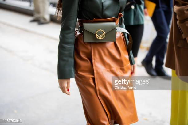 A guest is seen wearing olive Fendi belt bag outside the Fendi show during Milan Fashion Week Spring/Summer 2020 on September 19 2019 in Milan Italy